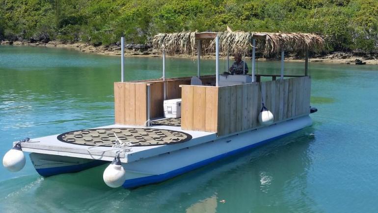 32' flat deck Sun Tracker pontoon barge with 115 hp four-stroke Yamaha